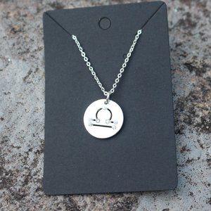 Jewelry - [5/$25] Silver Disc Symbol Charm
